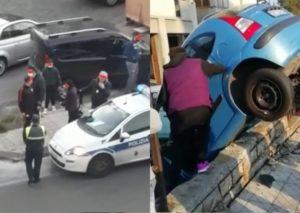 Ordinaria follia a Catania: auto sul muretto e decine di persone in strada (senza mascherine)